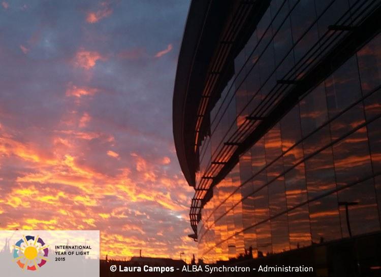 CELEBRATING THE INTERNATIONAL YEAR OF LIGHT 2015 - Sunlight reflecting on ALBA's building at evening