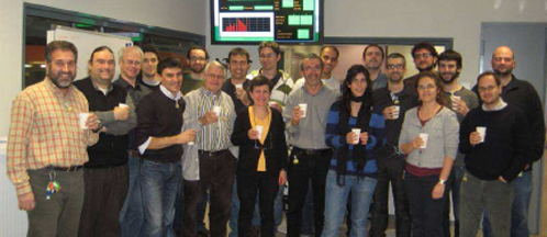 People celebrating booster and storage ring installation